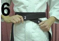 "Nancy McClean shows ""How To Tie Your Belt"""